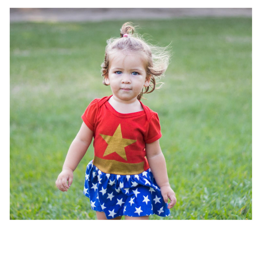 little girl dressed as superhero